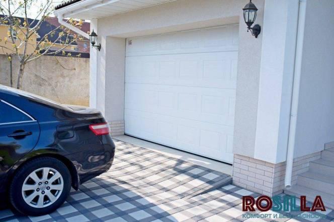 Виды гаражных ворот и особенности их выбора